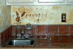 Hand painted mural in the kitchen of the Bosque Suite